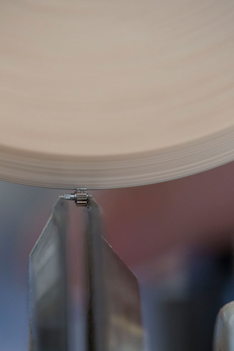 Closeup view of a traditional finishing technique with wooden wheel